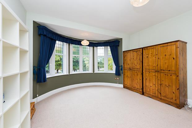 A bedroom with swept bay window