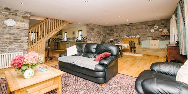 The downstairs is open plan, with a living area with a wood-burning stove