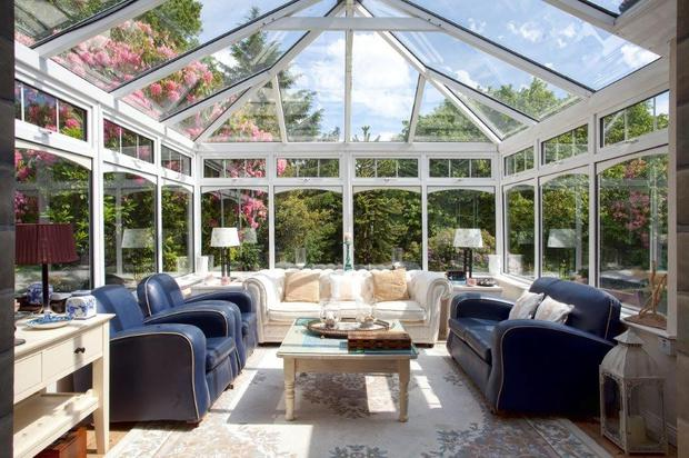 The conservatory has a stone fireplace fitted with an electric fire