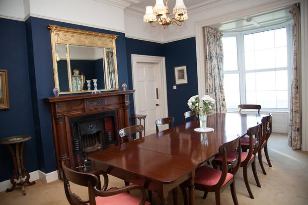 Dining room with timber fireplace