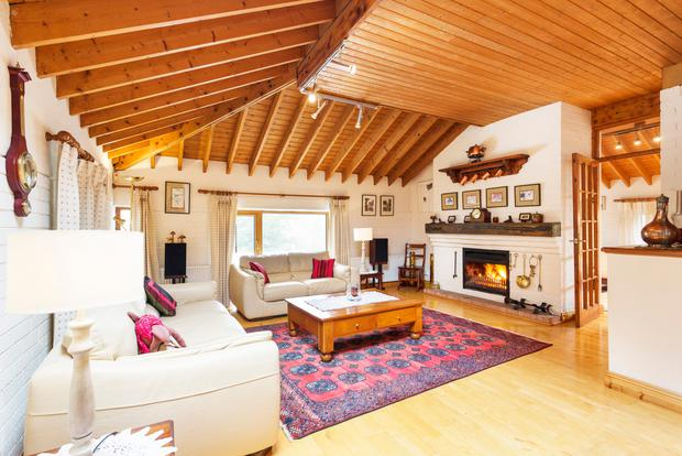 Pine beamed and panelled living room with a wood-burning stove