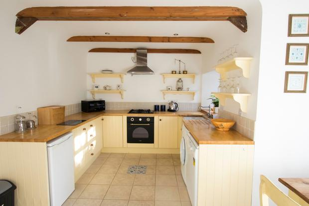 Kitchen with timber beams