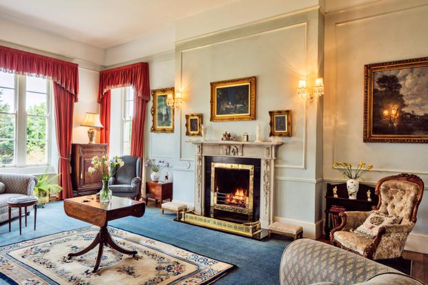 The dual-aspect drawing room with a fireplace