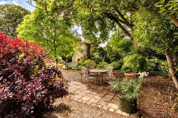 The grounds comprise 52 acres including woods, lawns, a walled garden and a folly