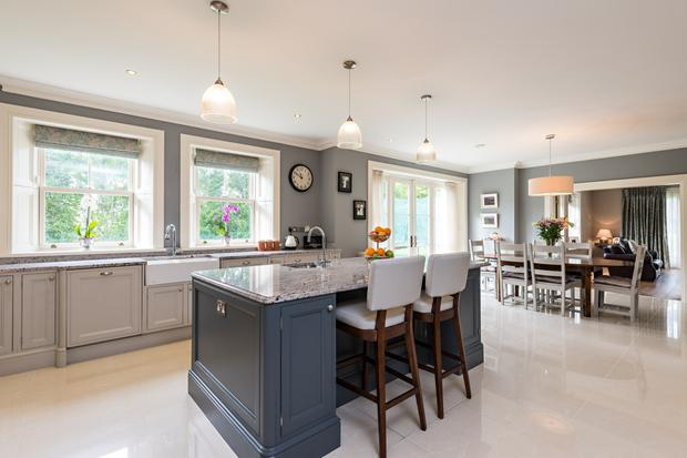 The kitchen has a centre island and French doors to the patio