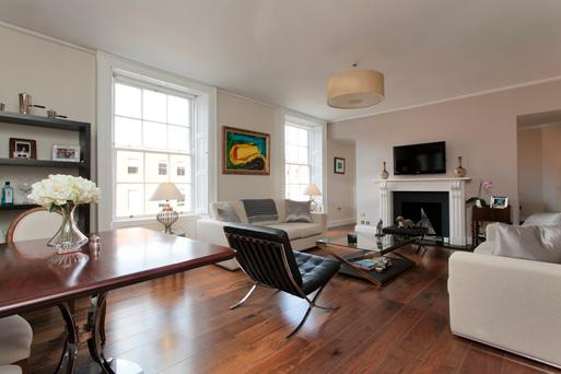 The open-plan sitting room with full-size twin sash windows