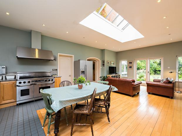 The large bright kitchen and family room features an atrium roof