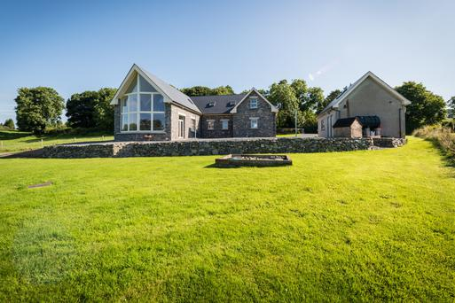 This solid cut-stone house was built eight years ago and designed by local architect Paul Taite