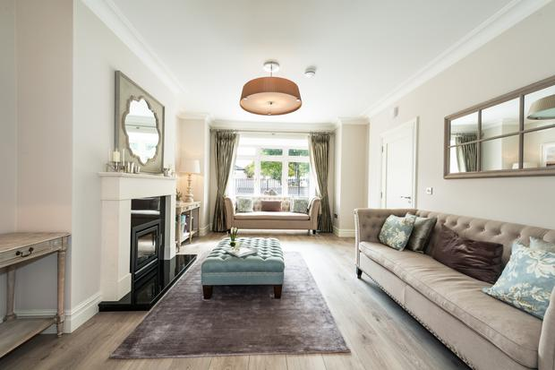 The main living room which flows through to an open-plan kitchen/dining room