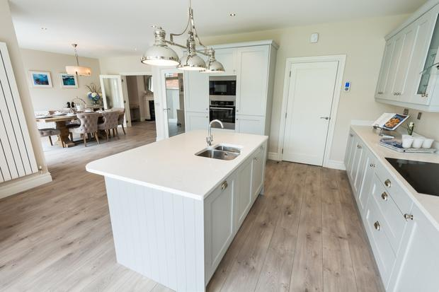 Kitchen with French doors leading out to the back garden