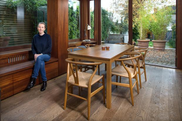 Eleanor McGarry in the dining area of her large family kitchen. The different woods embue the space with texture, while views of the garden on two sides add charm. Photo: Tony gavin