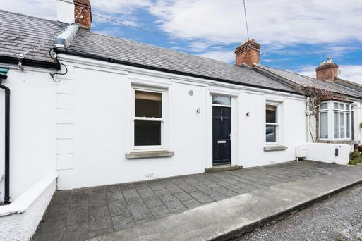 The cottage, which is 1,141 sq ft, has two bedrooms on either side of the entrance hall