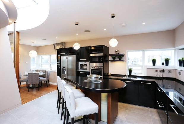 The kitchen features an island unit