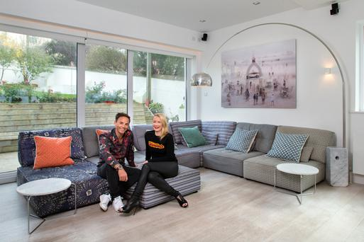 Clifden Foyle and Orna Holland in their informal living area off the kitchen. Colour is added by means of art and the seating unit, which is from Arnotts. Photo: Tony Gavin