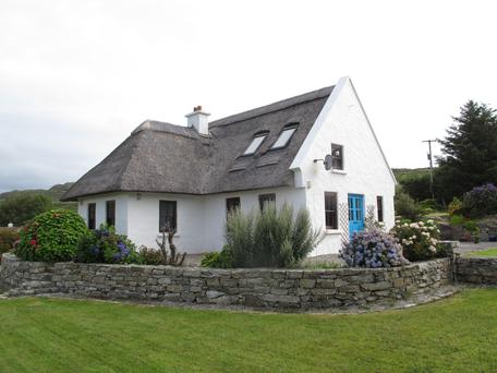 The Ferns, a thatched cottage built 20 years ago, is located on an elevated site overlooking Cloonisle pier and bay