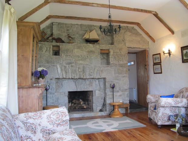 The living room with exposed beams;
