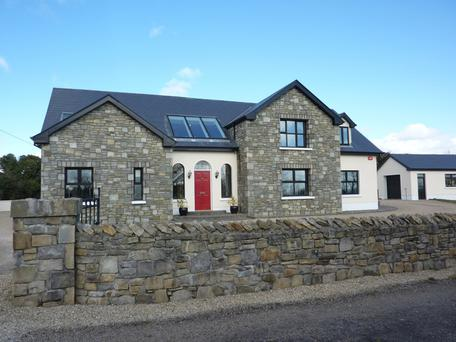 This 3,434 sq ft house near Castlebar sits on 0.6 of an acre and includes a detached garage