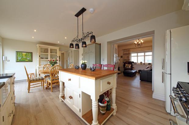 The eat-in kitchen has a centre island with a breakfast bar