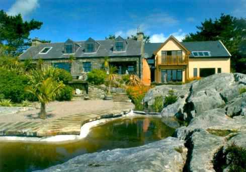 Shambala's gardens include rock pools and water features as well as semi-tropical plants