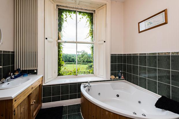 One of the main bathrooms with a corner bath