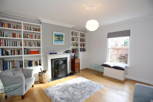 The living room with customised bookshelves