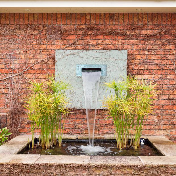 A modern water feature creates atmosphere in the garden