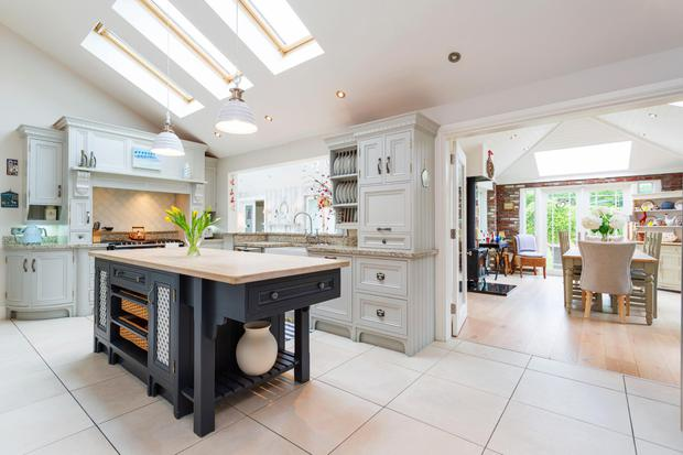 The kitchen has a de rigueur central island and opens through double doors to the dining room