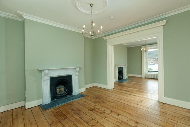 The two main interlinked reception rooms with white marble chimney pieces