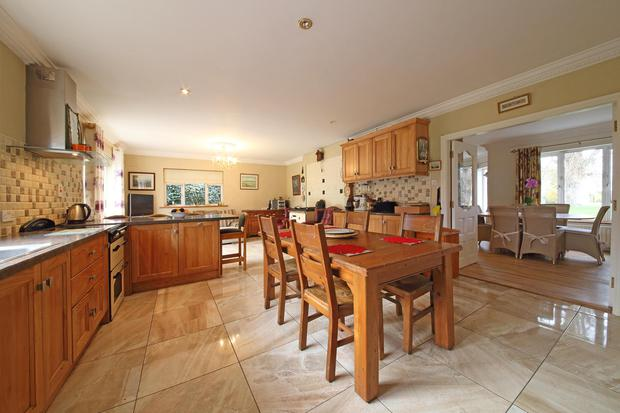 The open-plan kitchen and dining room has oak fitted cabinets