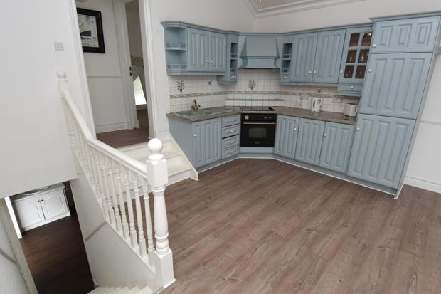 The kitchen with hand-painted units