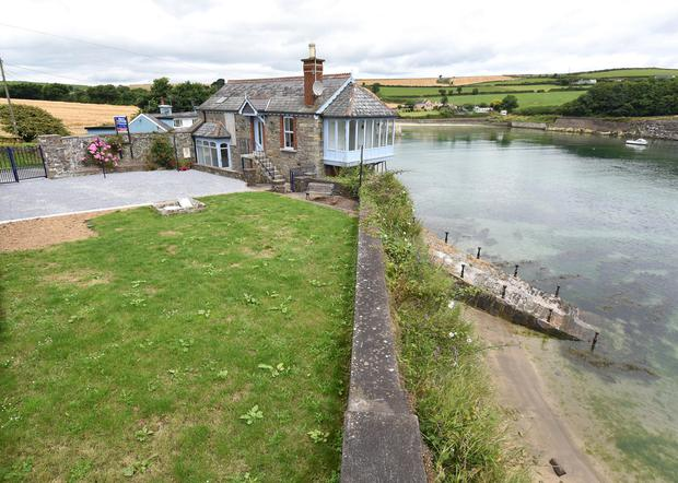 The home, which is a former coastguard station, is on the market in Cork for €400k.
