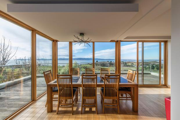 The dining area with floor-to-ceiling views over Dublin Bay