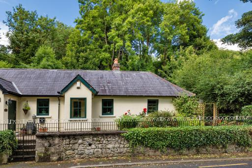 This semi-detached cottage has been restored and modernised by the current owners