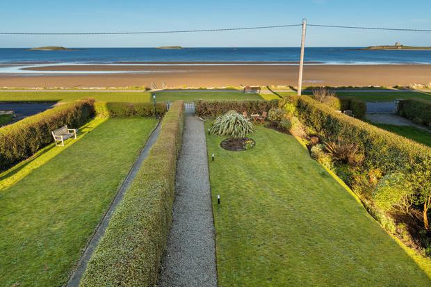 The 90ft long front garden is almost right on the beach