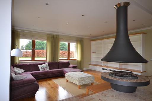The open-pit fireplace and chimney feature