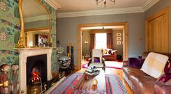 The interlinking reception rooms feature original polished timber board floors