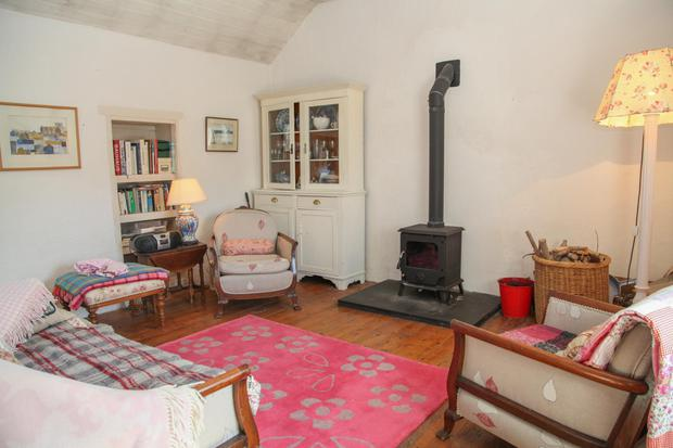 The living area also has a wood-burning stove