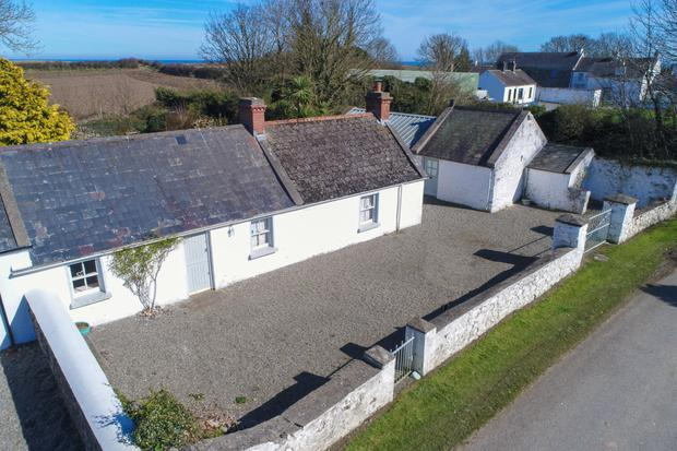 Aerial view of the cottage and converted 'pig shed'
