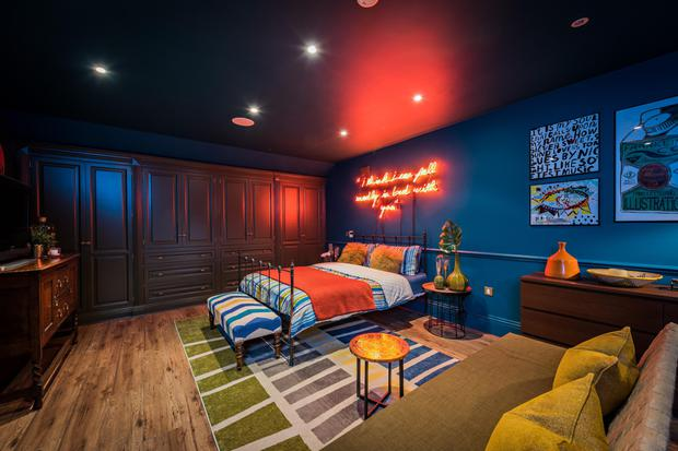 An eclectic neon-lit bedroom