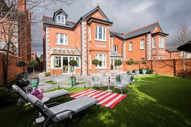 The rear of 52 Orwell Park, which has astroturf instead of grass for easy maintenance