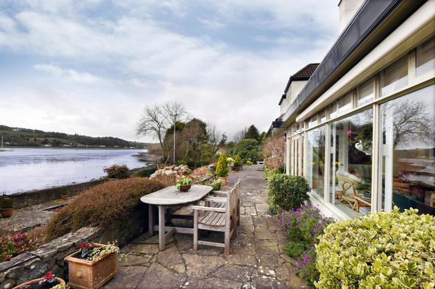 The terrace overlooks the water