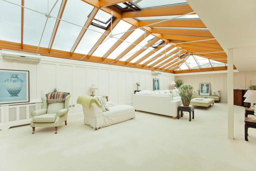 The family room with its glass-vaulted ceiling