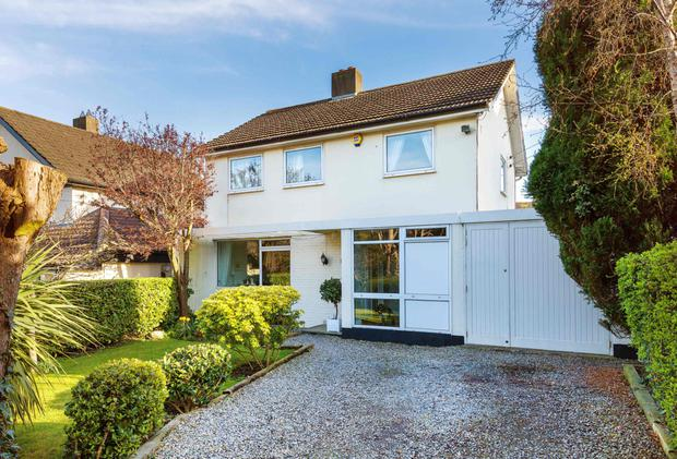 The four-bedroom house has a well-tended front garden and a carefully planned back one