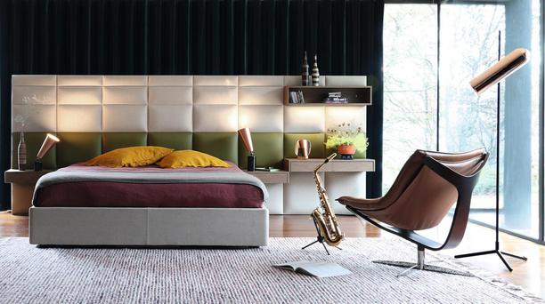 The Roche Bobois Coucheval headboard has built-in shelves
