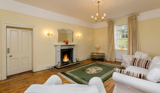 The living room has a pitch pine floor and a marble fireplace