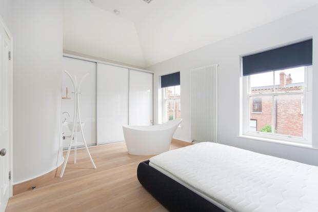 The master bedroom has a tub
