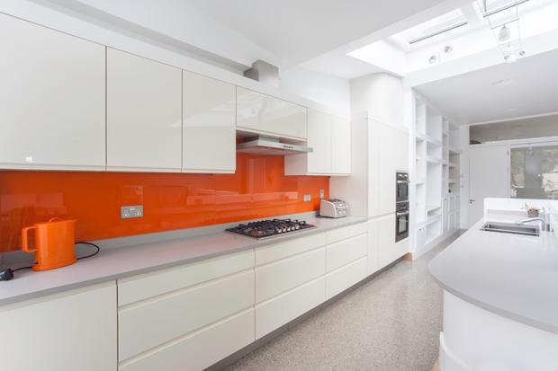 The tangerine splash-back kitchen