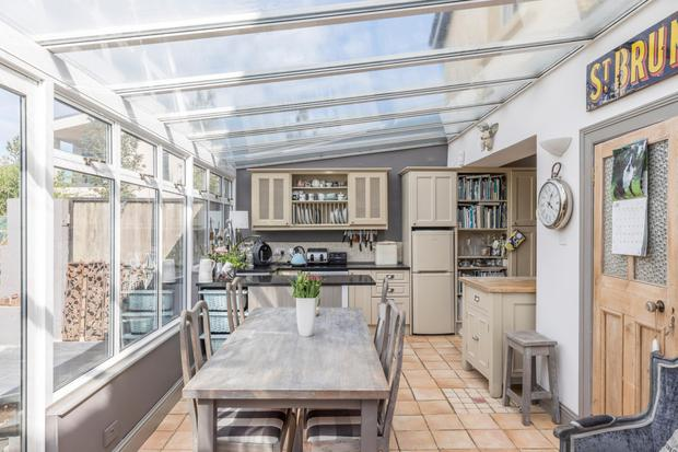 The sun room dining room comes with a tiled floor