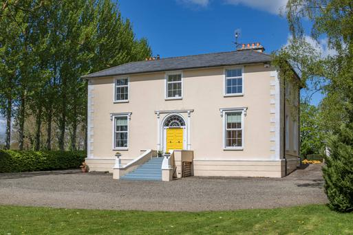 The symmetrical Brook House in Rathregan is on two storeys over a raised basement