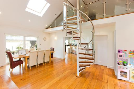 The spiral staircase leads to a mezzanine